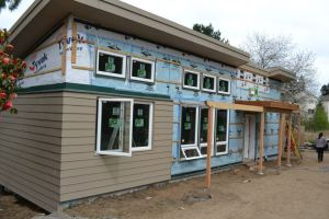 Front of the Emerald House. Metal siding will cover the remaining housewrap portions.